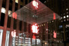 Apple dresses up stores with red logos, employees wear red shirts for World AIDS Day