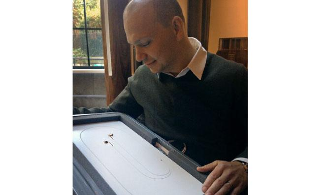 Tony Fadell with Product RED EarPods