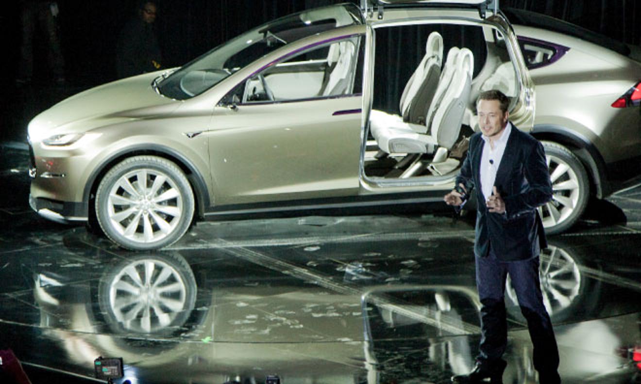 Tesla CEO Elon Musk with the company's forthcoming Model X SUV