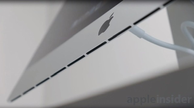The iMac hides its exhaust vents underneath the screen
