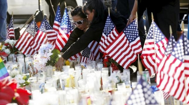 San Bernardino mourns those lost as FBI confronts Apple