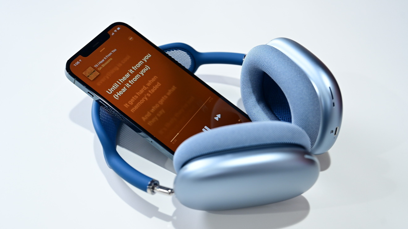 Apple's headphones paired with an iPhone and Apple Music