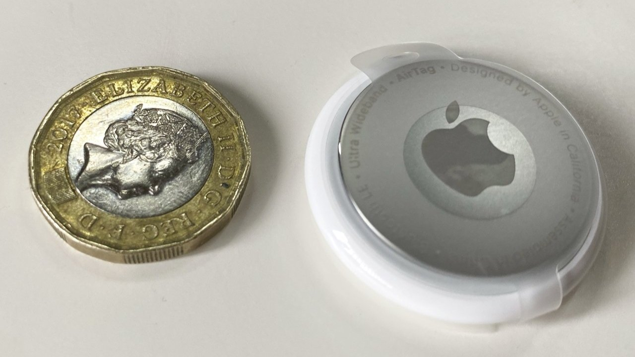 AirTag size compared to a British Pound