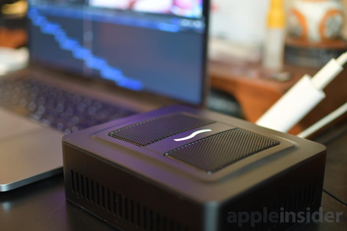 Sonnet eGPU Puck next to Apple MacBook Pro