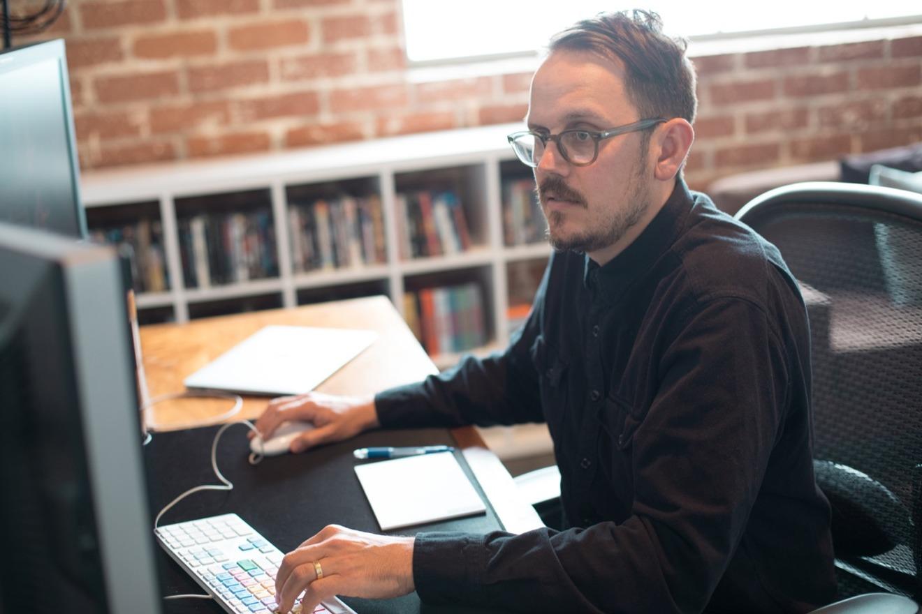 Jeff Buchanon Editor Sitting