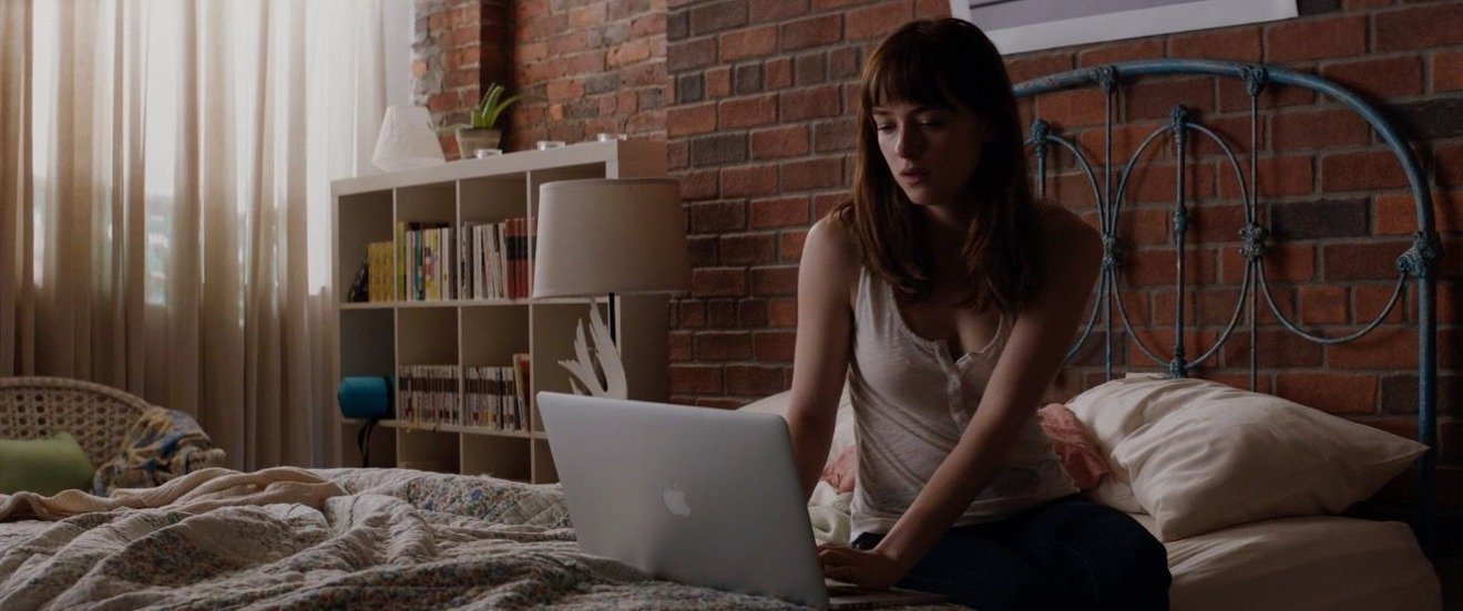 Ana Steele in Fifty Shades of Grey with a MacBook