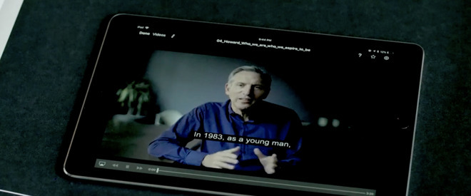 Howard Schultz addreses employees on an iPad