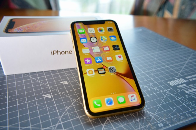 iPhone XR leaning on its box