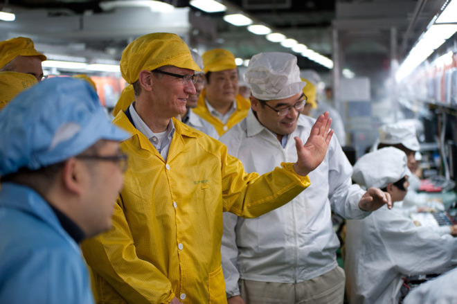 Apple CEO Tim Cook visiting a Foxconn factory