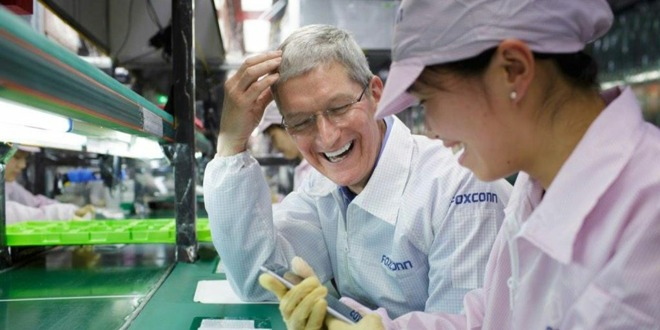 Apple CEO Tim Cook on a visit to a Foxconn factory.