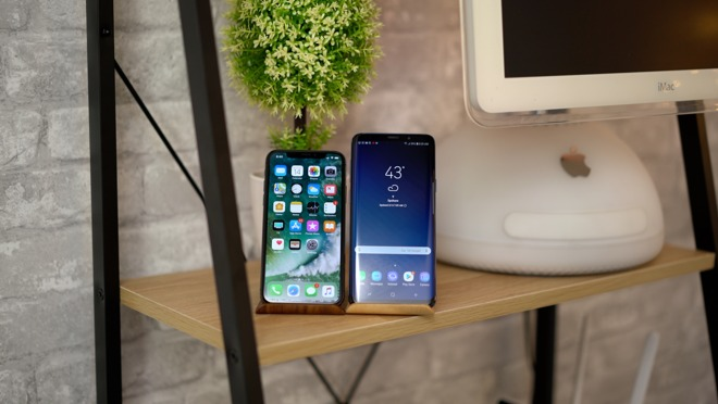 The iPhone X next to the Galaxy S9