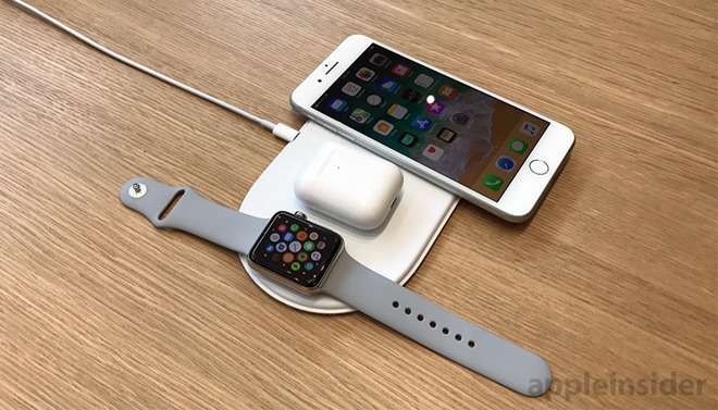 An Apple illustration of a wireless charging AirPods case on the unreleased AirPower charging mat