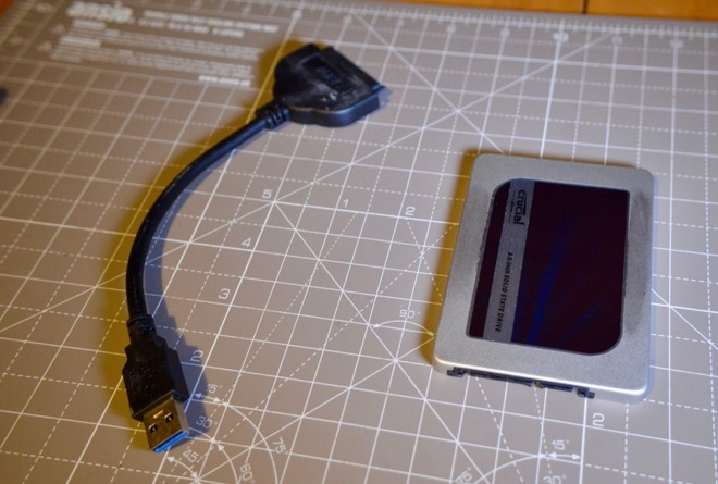 The new SSD and the USB-to-SATA cable for data transfers