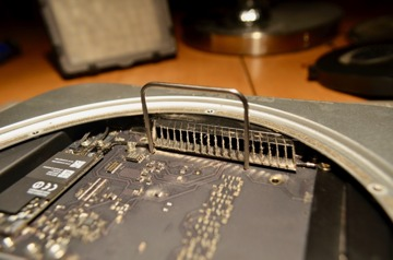 Inserting the logic board removal tool into its two holes