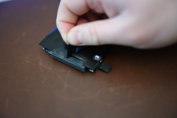 Untaping the SATA connector from the old drive