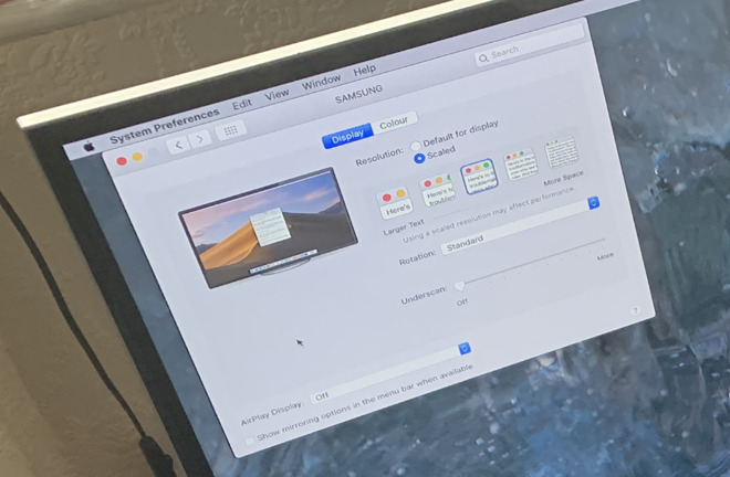 Adjusting the Mac's display preferences through a TV screen