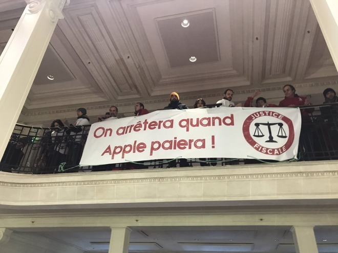 Protestors in an Apple Store in France campaigning for Apple to pay more tax