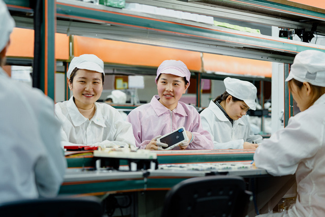 Line operators at an iPhone production facility in China awarded the Green Factory designation.