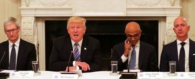 Cook sitting next to President Trump at an early White House meeting
