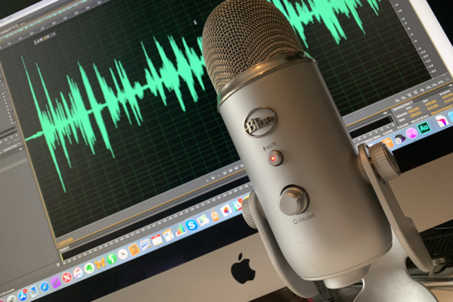 A Blue Yeti microphone in front of a Mac