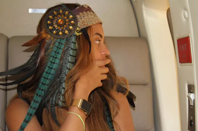 Beyonce posing with her all-gold Apple Watch Edition, customized for her by Apple.
