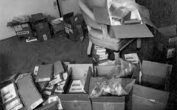 Boxes of fake iPhones found at suspects' homes. Source: US Attorney's Office via KION