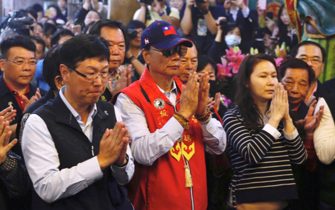 Gou praying at his temple appearance. | Image Credit: Reuters/Tyrone Siu