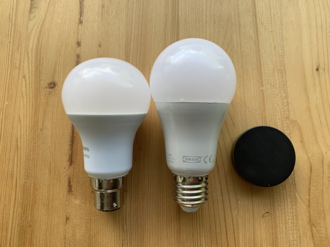 Ikea's bulbs (right) are taller than Phillips Hue ones (left). Notice the old-style bayonet cap on the bottom of the Hue. Phillips sells both bayonet and screw-fit bulbs. Ikea only makes screw ones, but does sell adaptors.