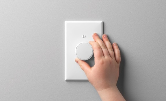 Lutron's Aurora dimmer for Philips Hue lighting installs over a light switch
