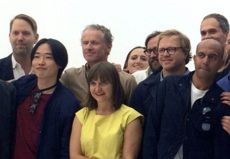 Evans Hankey (dressed in yellow) with other members of the design team [via MacGeneration]