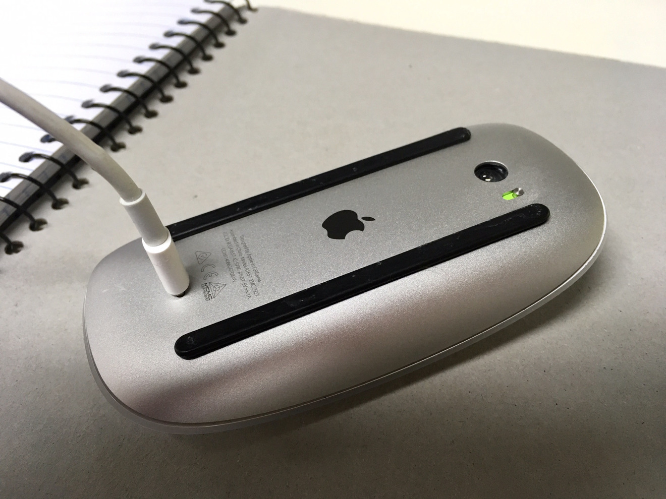 A Magic Mouse 2 being recharged