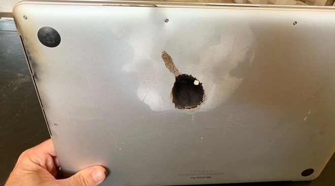The hole in the base of the 15-inch MacBook Pro following a battery failure (via Steve Gagne/Facebook)
