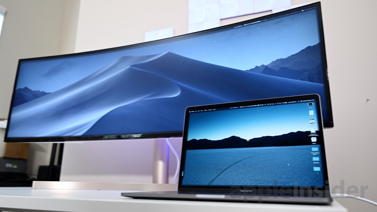 The 49-inch LG UltraWide and a 15-inch MacBook Pro