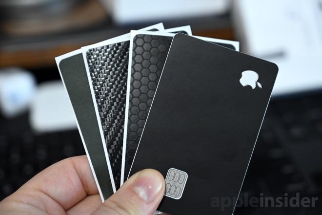 Camo, carbon fiber, swarm, and matte black dbrand Apple Card skins