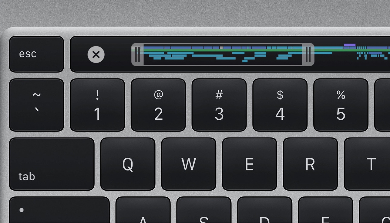 A redesigned keyboard has a dedicated escape key, Touch ID sensor, and an inverted 'T' for arrow keys
