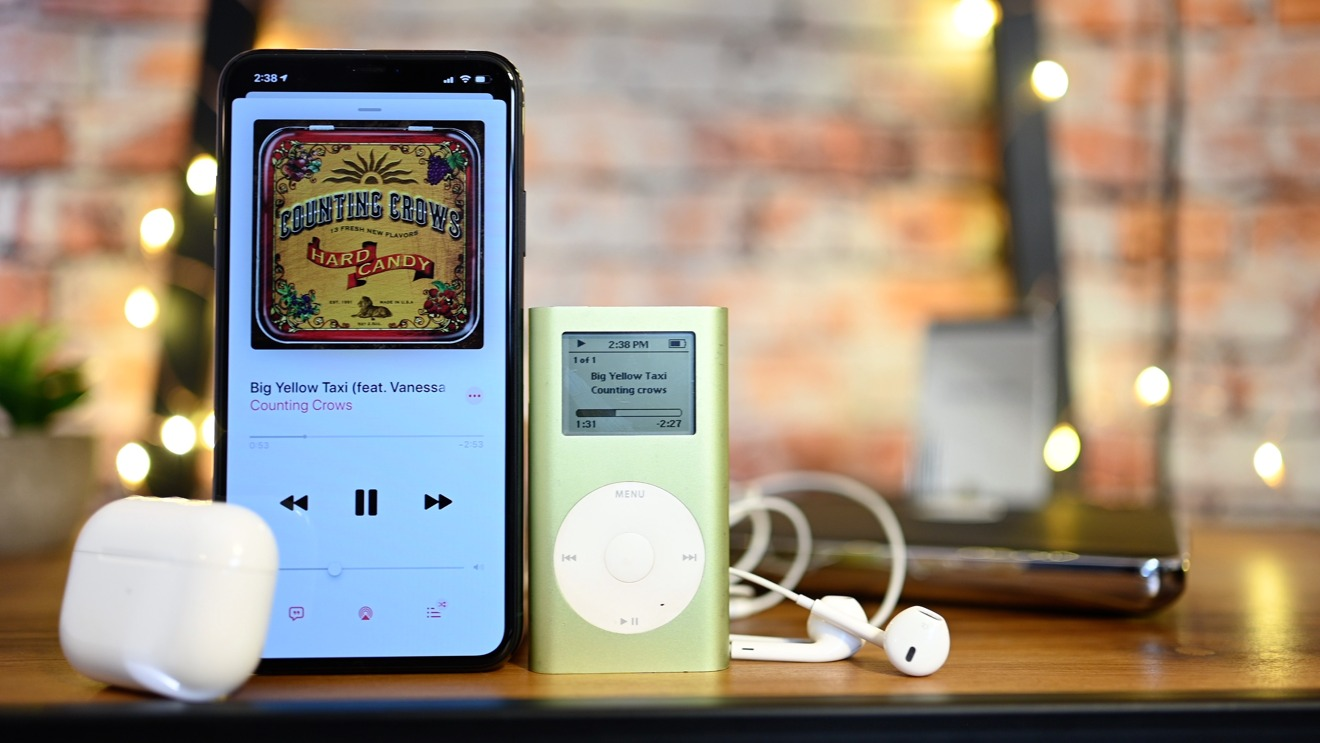 An iPhone 11 Pro Max with AirPods next to our iPod mini with wired earbuds