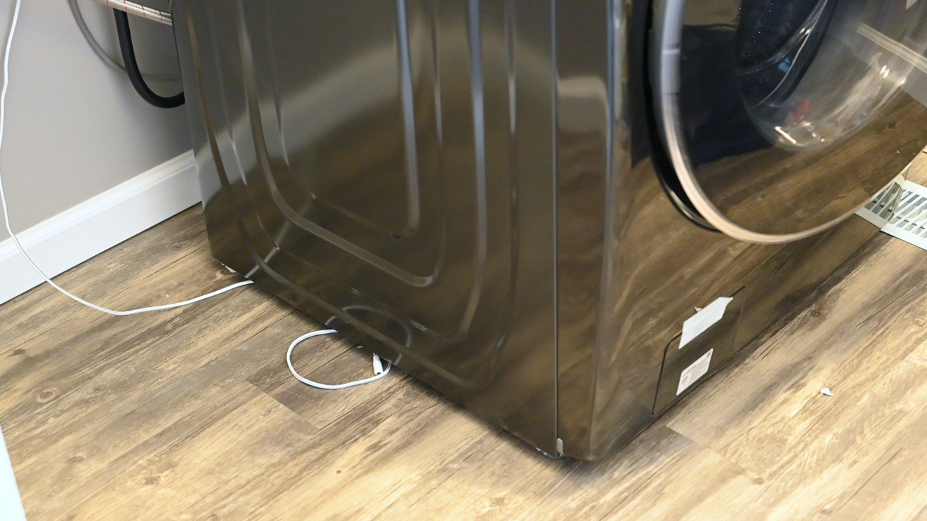 Eve Water Guard installed behind a washing machine
