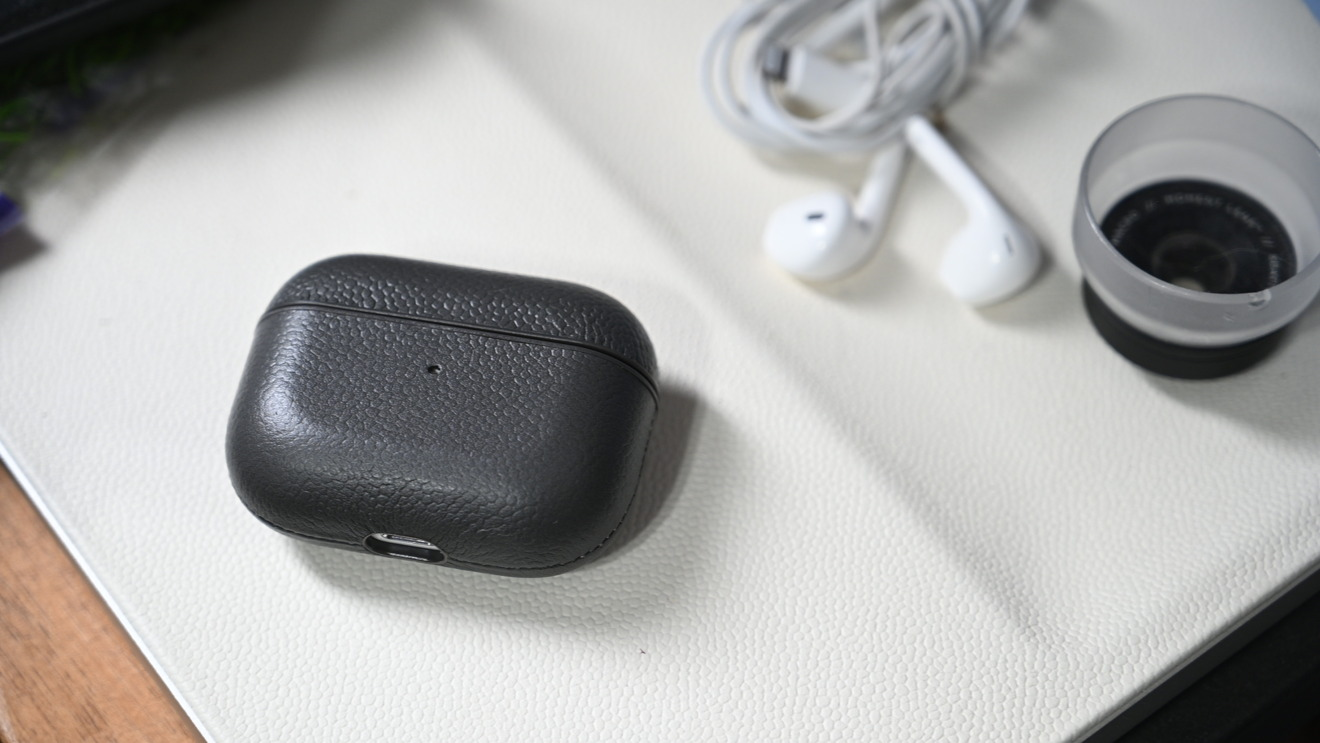 Courant's AirPods Pro case on the Courant wireless charging valet