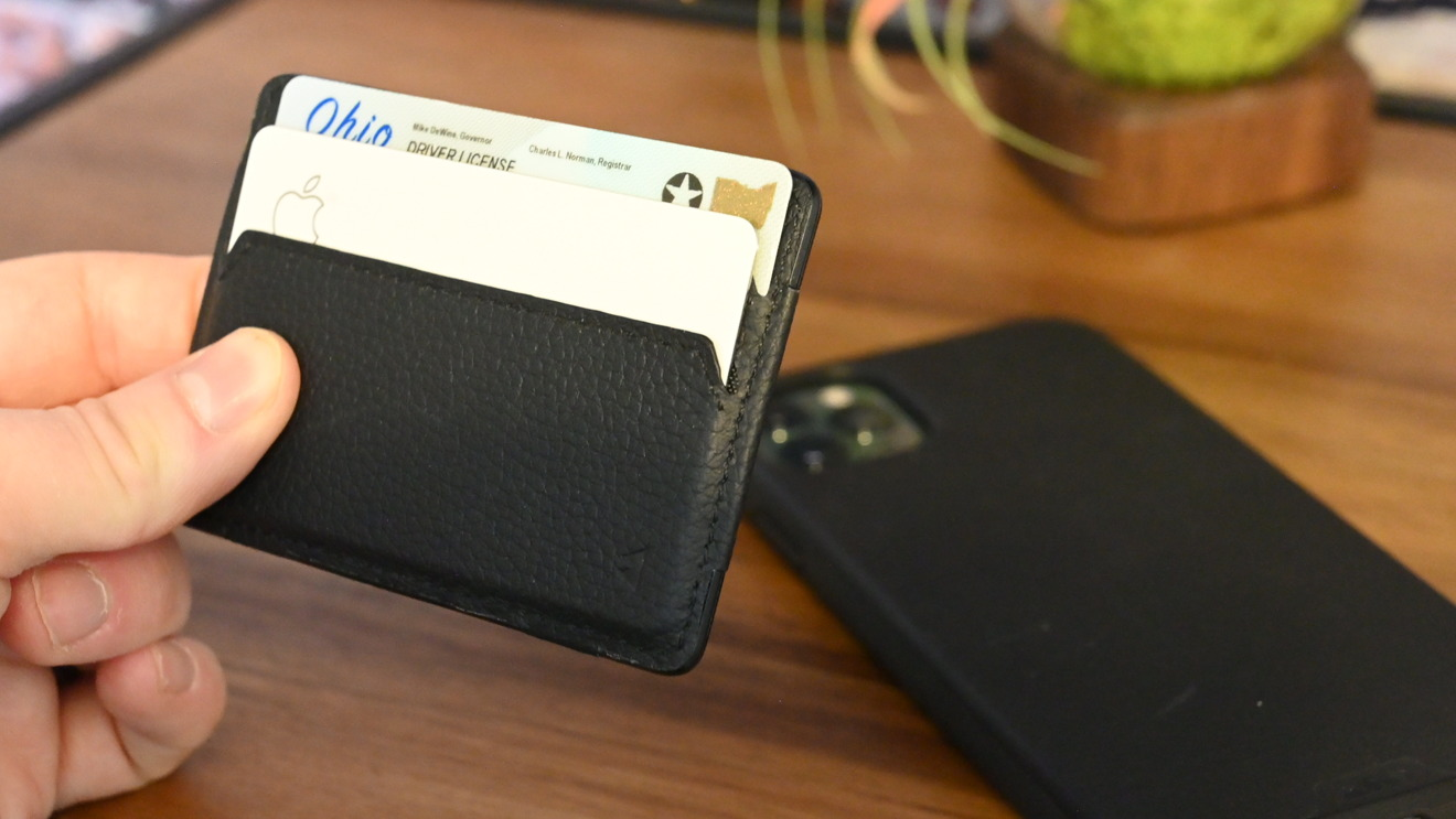 Mous Card Wallet is slim, holds two cards, is wrapped in leather, and magnetically connects to the back of the phone case