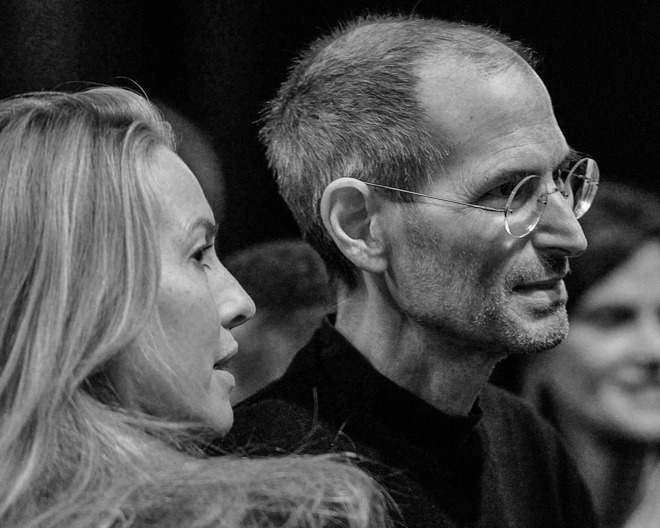 Laurene Powell Jobs and Steve Jobs at a 2011 Apple conference(photo credit: Bloomberg)