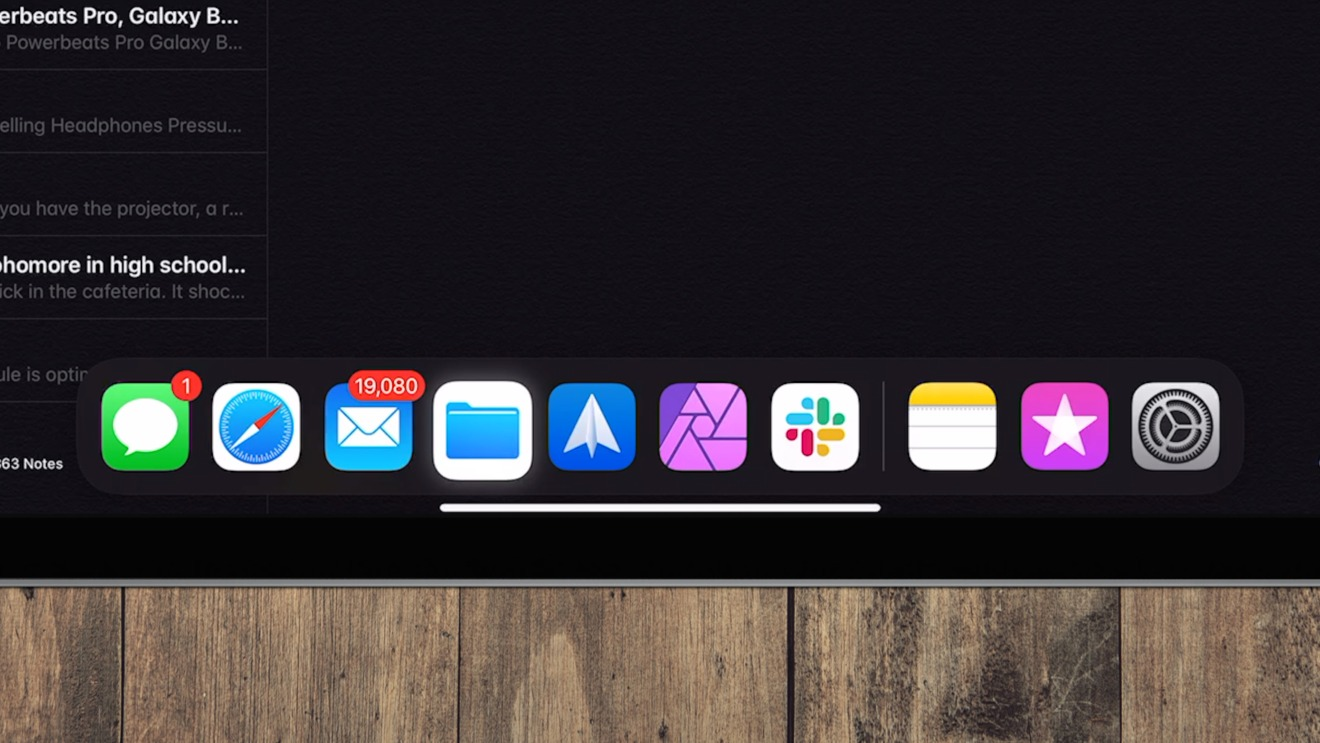 Drag the cursor to the bottom to access the Dock within apps