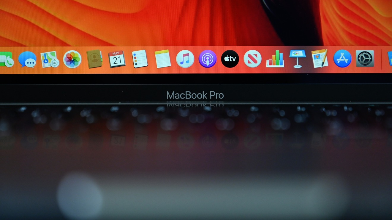 Closeup of the MacBook Pro logo below the gorgeous Retina display