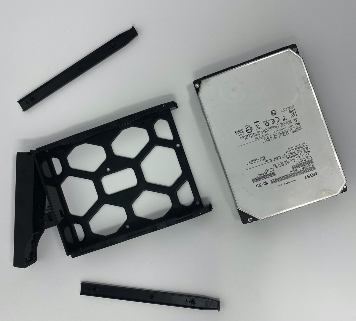 Loading a hard drive into a Synology DS-1618+ network attached storage device