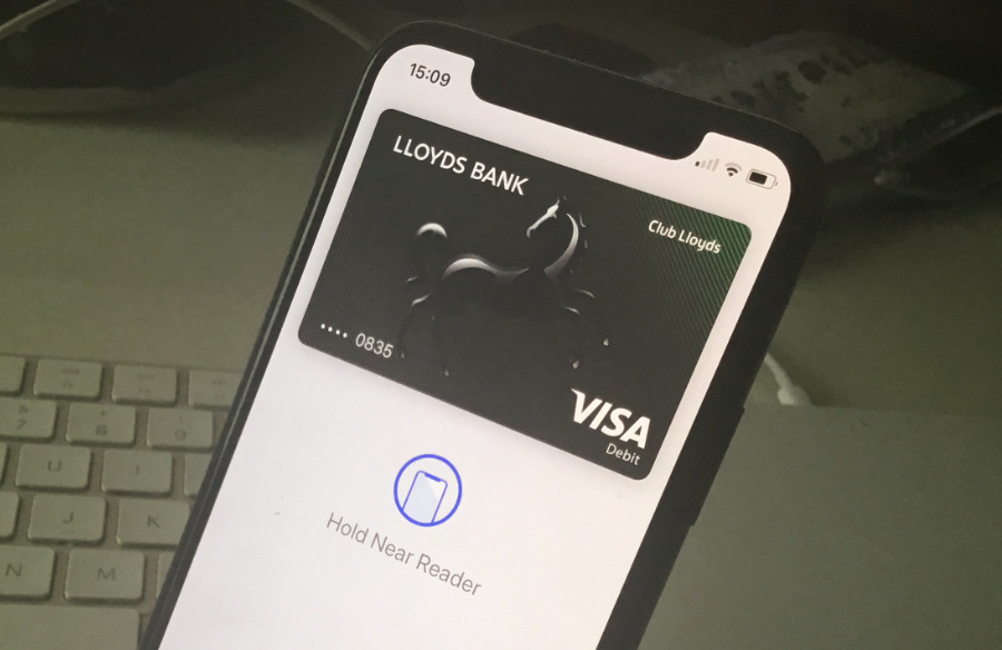 Hold your iPhone near the vendor's card reader and double-press the side button