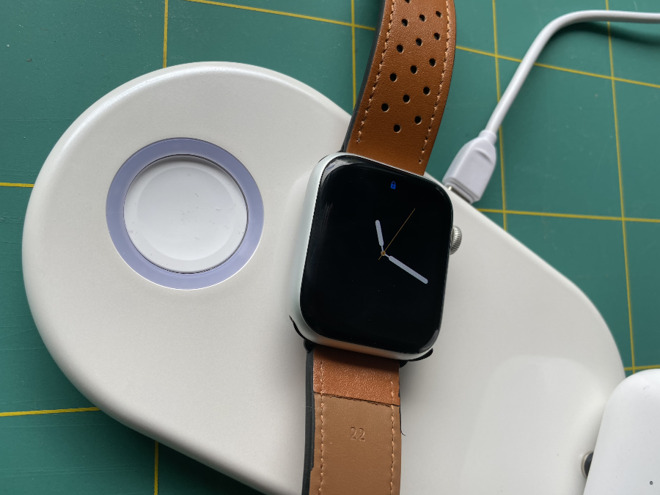 The Apple Watch charging part (left) is loose, but it snaps up when you place the Watch on it