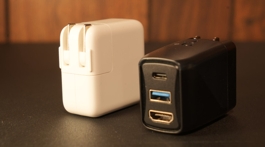 Apple's 30W charger is much larger than the Genki Covert Dock