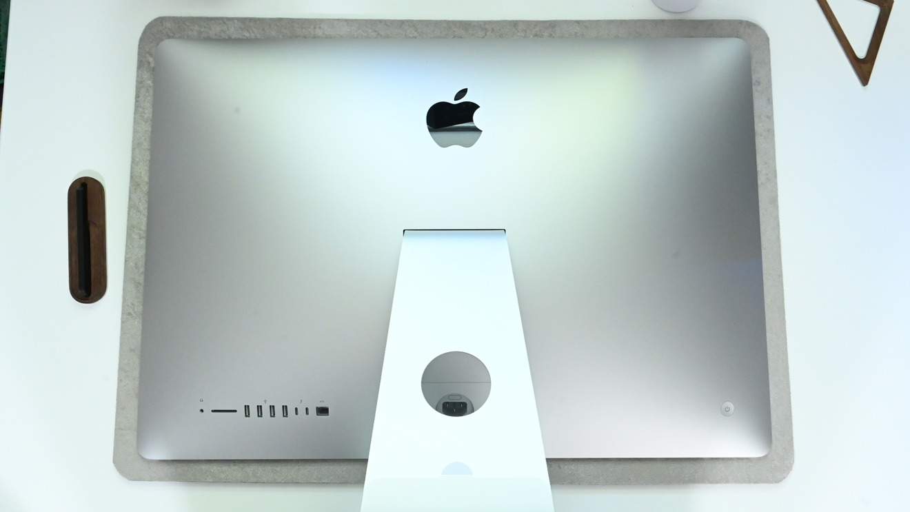 Place your iMac face down on a protected surface