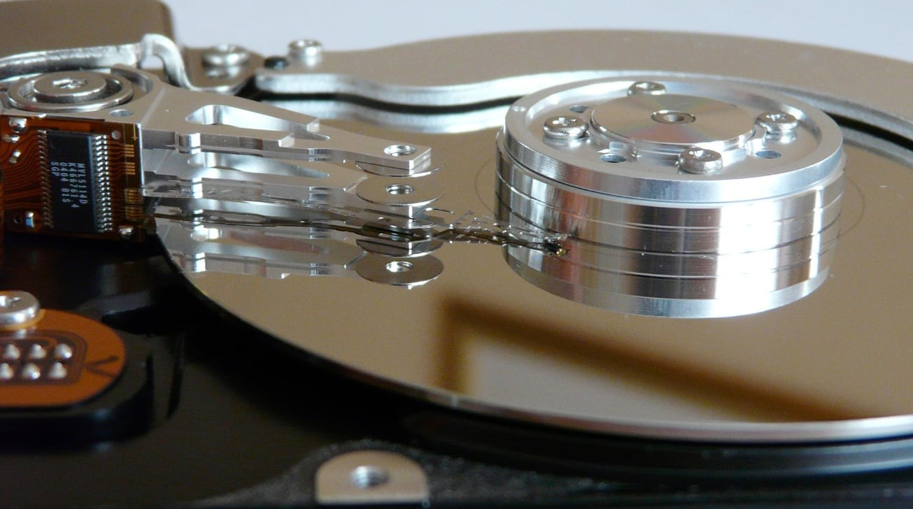 A hard drive platter with a read head floating above.