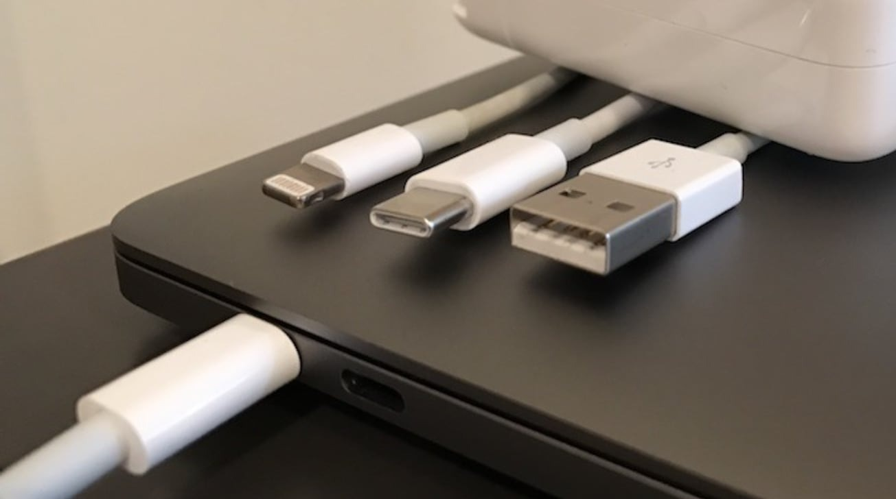 Cables for Lightning, USB Type-C, and USB Type-A, along with a MacBook Pro's Thunderbolt 3 ports