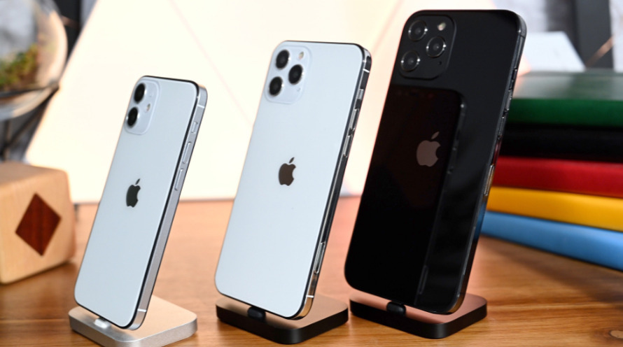 Physical mock-ups of three 'iPhone 12' models